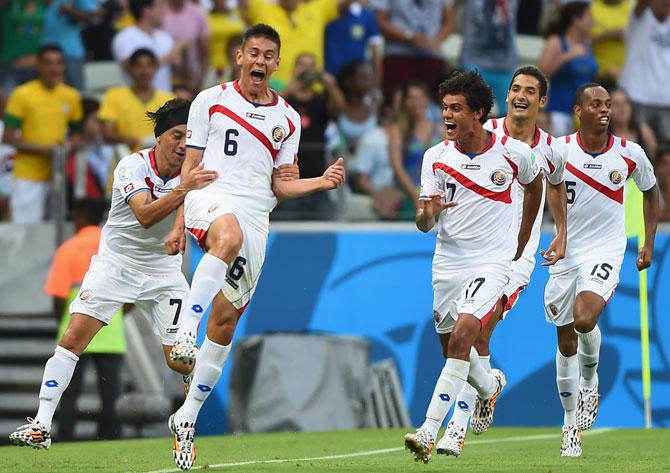 Costa Rican players celebrate a goal