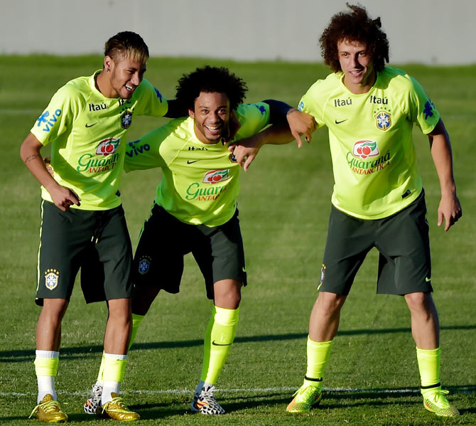Neymar (left), Marcelo (centre) and David Luiz link up to defend the ball during a training session at the President Vargas stadium in Fortaleza on Thursday, the eve of their quarter-final match against Colombia