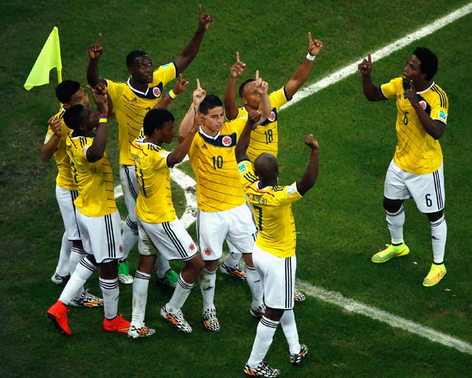 Colombia's players celebrate after James Rodriguez scored the second goal against Uruguay