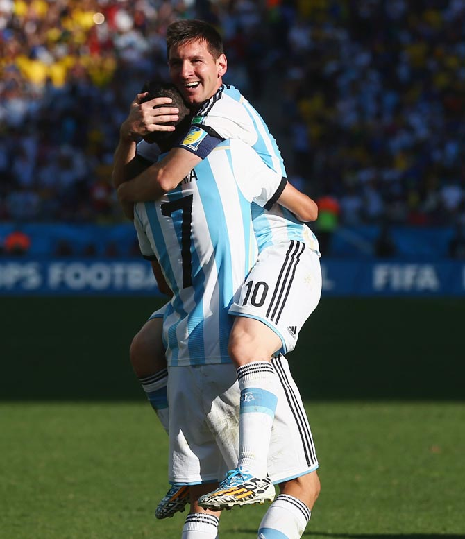 Angel di Maria of Argentina (left) celebrates with Lionel Messi after scoring the winner in extra time against Switzerland