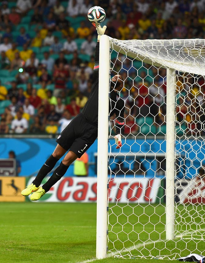 US goalkeeper Tim Howard makes a fingertip save against Belgium
