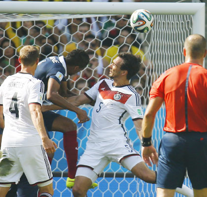 Germany's Mats Hummels (secong from right) heads the ball to score the team's goal against France