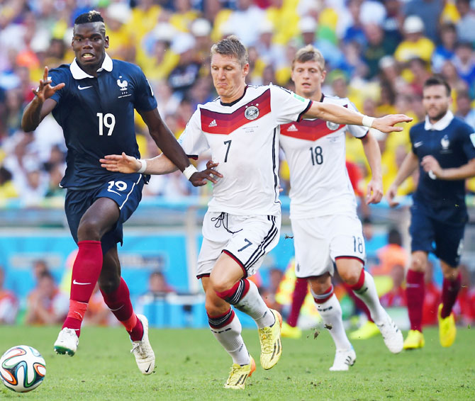 Paul Pogba of France and Bastian Schweinsteiger of Germany compete for the ball