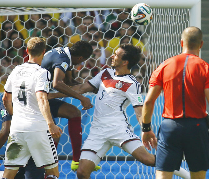 Germany's Mats Hummels (No 5) heads the ball to score the team's goal against France