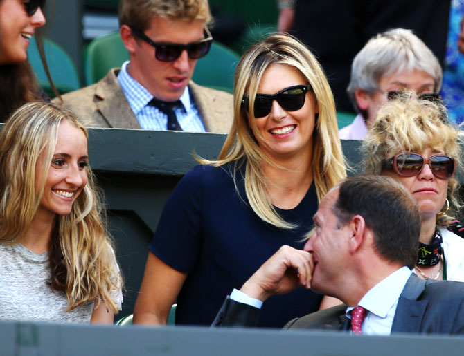 Maria Sharapova of Russia watches Gentlemen's Singles semi-final match