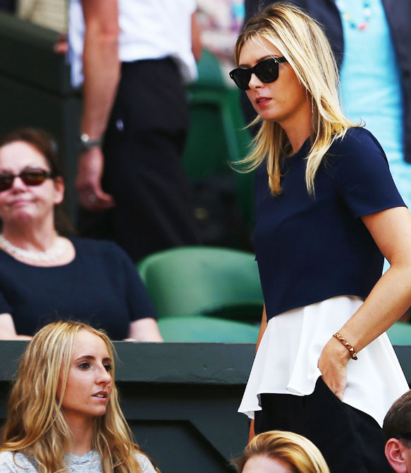 Maria Sharapova of Russia the girlfriend of Grigor Dimitrov of Bulgaria watches his   Gentlemen's Singles semi-final match against Novak Djokovic of Serbia