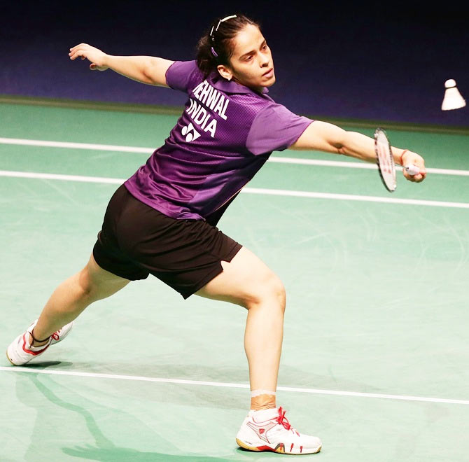 Saina Nehwal plays a dribble at the net