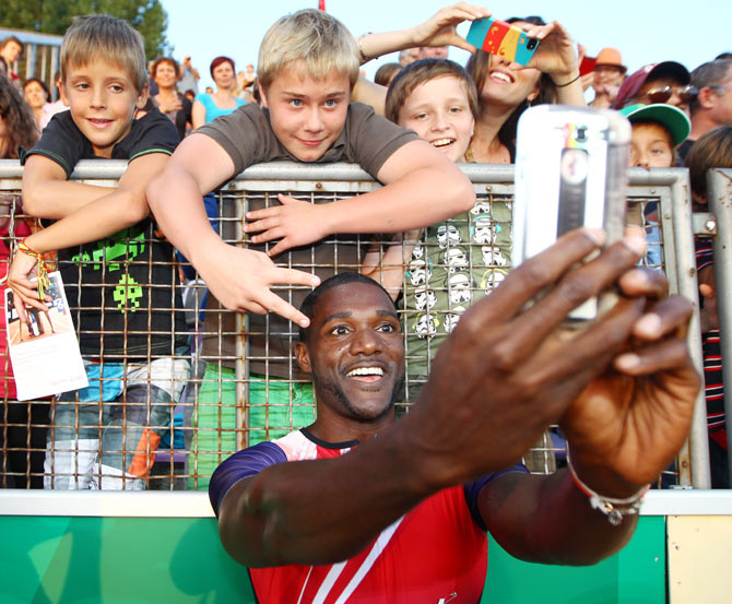 Justin Gatlin of USA celebrates with fans after winning the Men's 100m race at the IAAF Diamond League Athletics meeting 'Athletissima' in Lausanne, Switzerland, on Thursday