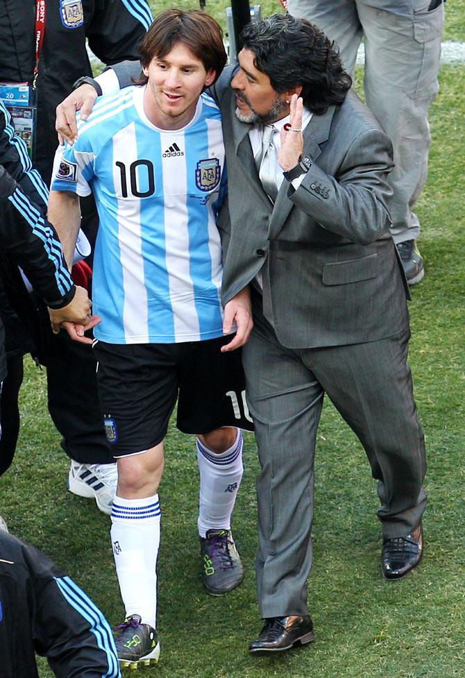Diego Maradona (right) talks with Lionel Messi