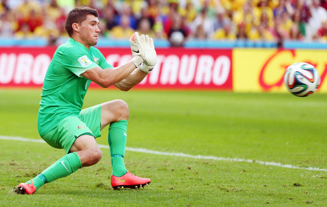 Mathew Ryan of Australia makes a save during the 2014 FIFA World Cup Brazil Group B match between Australia and Spain