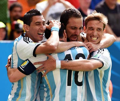 Argentina's players celebrate after Gonzalo Higuain scored the first goal against Belgium