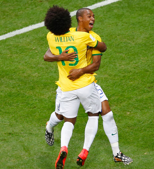 Fernandinho of Brazil (right) celebrates scoring his team's fourth goal with Willian against Cameroon