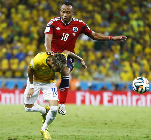 Brazil's Neymar (bottom) is fouled by Colombia's Camilo Zuniga during their quarter-final in Fortaleza