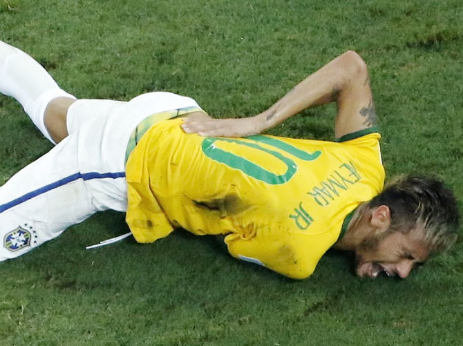Brazil's Neymar grimaces in pain after a challenge by Colombia's Camilo Zuniga during their quarter-final at the Castelao arena in Fortaleza