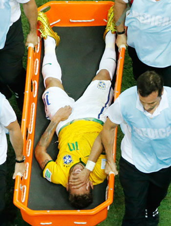 Neymar is stretchered off during the closing stages of the quarter-final match against Colombia