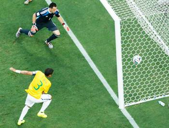 Thiago Silva send the ball past Colombia's goalkeeper, David Ospina