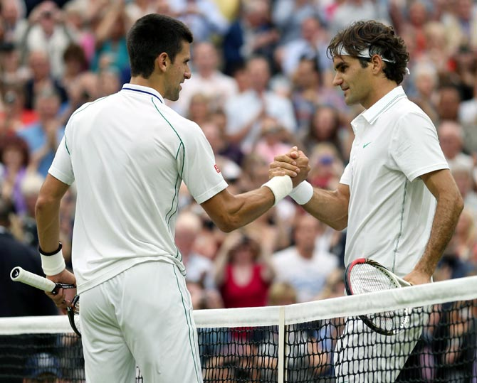 Roger Federer of Switzerland (right) with Novak Djokovic of Serbia