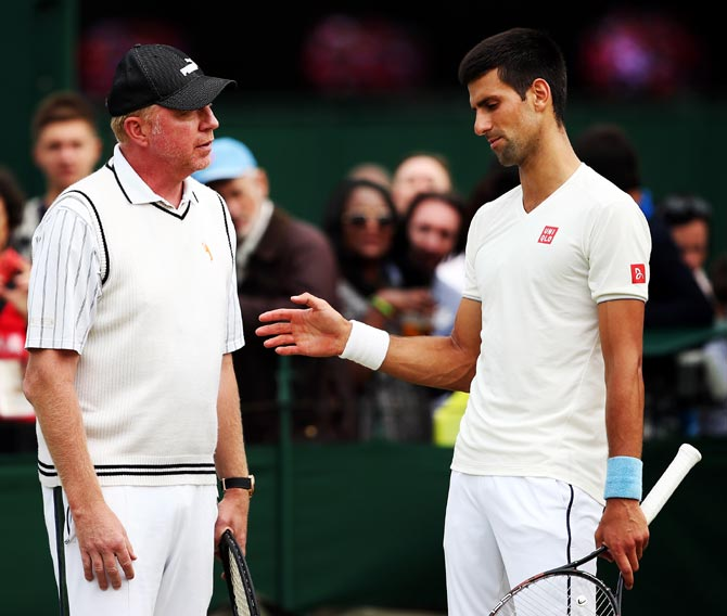 Novak Djokovic (right) with his coach Boris Becker during a practice session