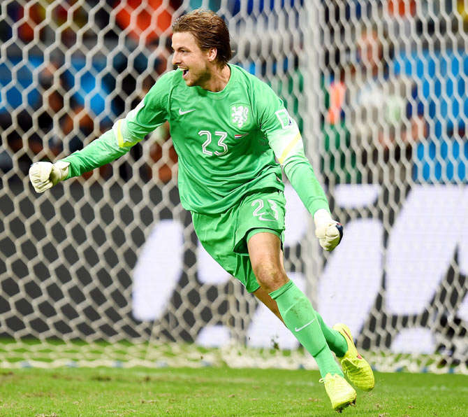 Goalkeeper Tim Krul of the Netherlands celebrates after making a save on a penalty kick by Michael Umana of Costa Rica