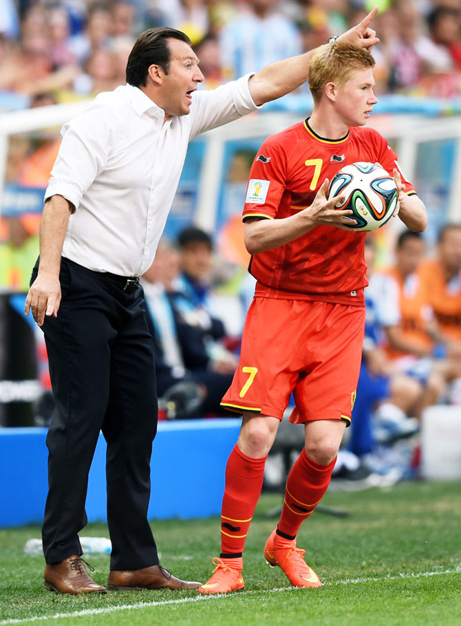 Head coach Marc Wilmots gestures as Kevin De Bruyne of Belgium prepares for a throw in during their  2014 FIFA World Cup quarter-final against Argentina at Estadio Nacional in Brasilia on Saturday