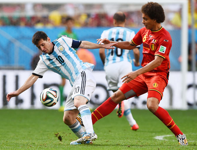 Lionel Messi of Argentina is challenged by Axel Witsel of Belgium during their 2014 FIFA World Cup quarter-final on Saturday