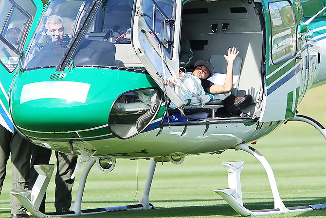 Brazil's Neymar is seen inside a medical helicopter at the Granja Comary training center, in Teresopolis, Brazil on Saturday