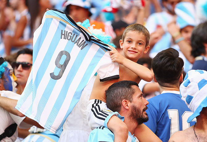 An Argentina fan holds up a Gonzalo Higuain shirt