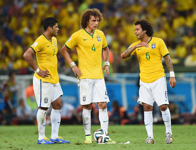 Hulk, David Luiz and Marcelo of Brazil prepare to take a free kick during the match against Colombia at Castelao