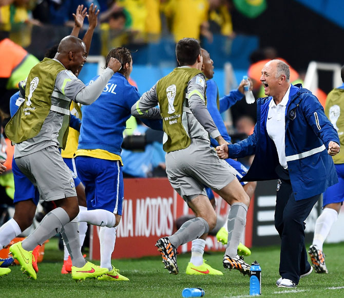 Brazil coach Luiz Felipe Scolari celebrates with his players