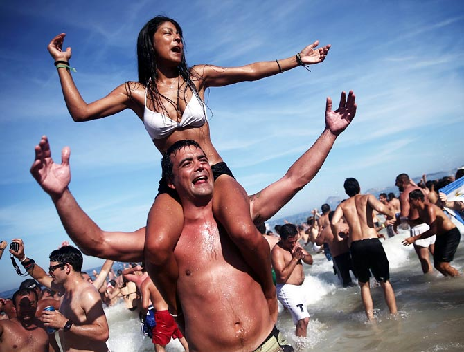 Argentina fans celebrate their victory over Belgium at Copacabana Beach
