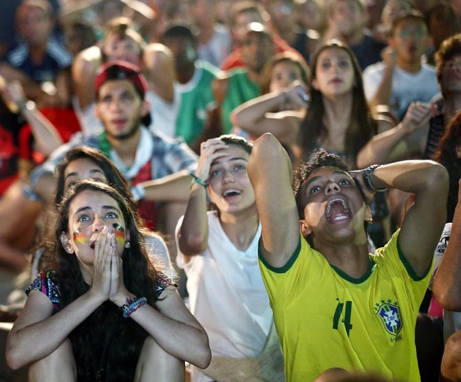 Fans react during the Germany-Algeria match at FIFA Fan Fest at Copacabana Beach