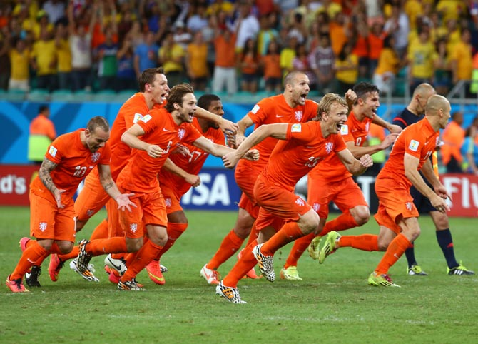 Netherlands celebrate after defeating Costa Rica in their quarter-final match
