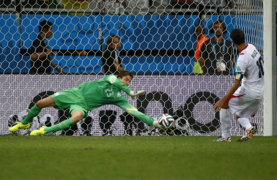Goalkeeper Tim Krul of the Netherlands saves a shot by Costa Rica's Bryan Ruiz