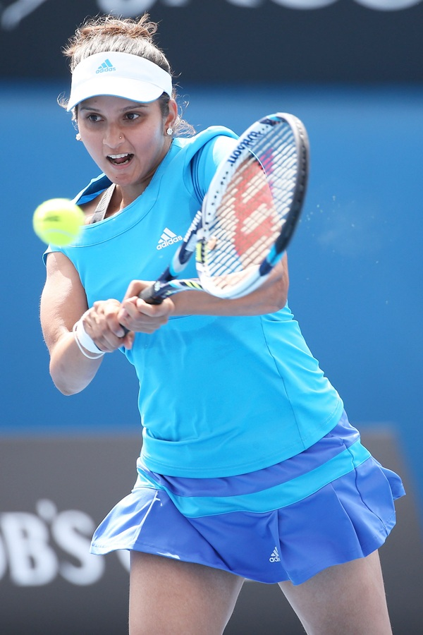 Sania Mirza of India plays a backhand