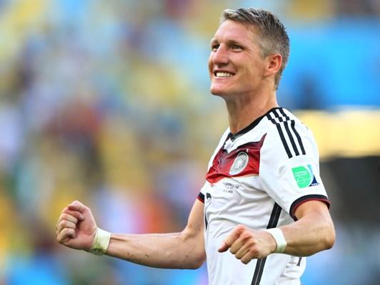 Bastian Schweinsteiger of Germany celebrates defeating France 1-0