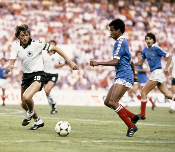 Jean Tigana of France in action against Manfred Kaltz of West Germany during the   1982 FIFA World Cup Semi Final on 8th July 1982 at the Ramon Sanchez Pizjuan Stadium in Seville, Spain