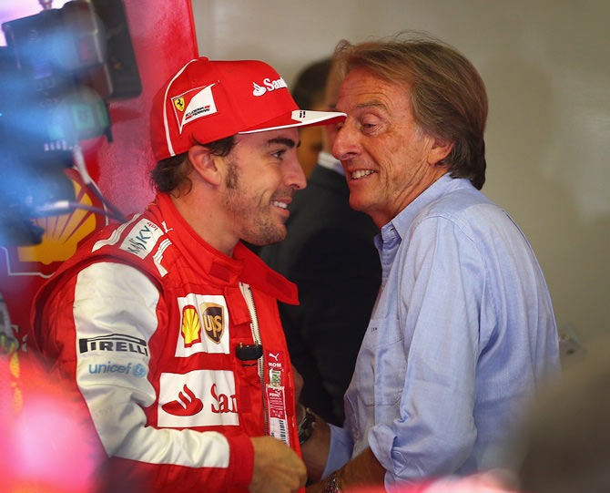 Ferrari Chairman Luca Cordero di Montezemolo, right, talks with Fernando Alonso