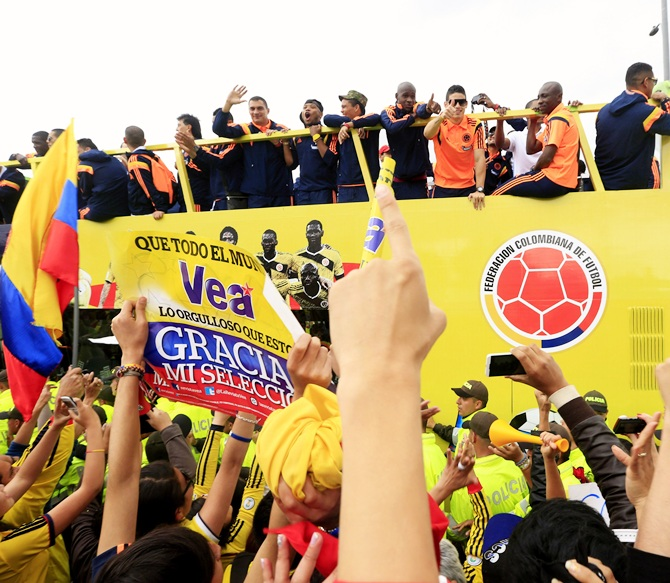 Colombia's national soccer team players are greeted by fans, at their arrival in Bogota
