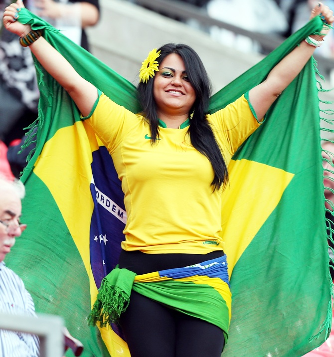 A Brazilian fan cheers