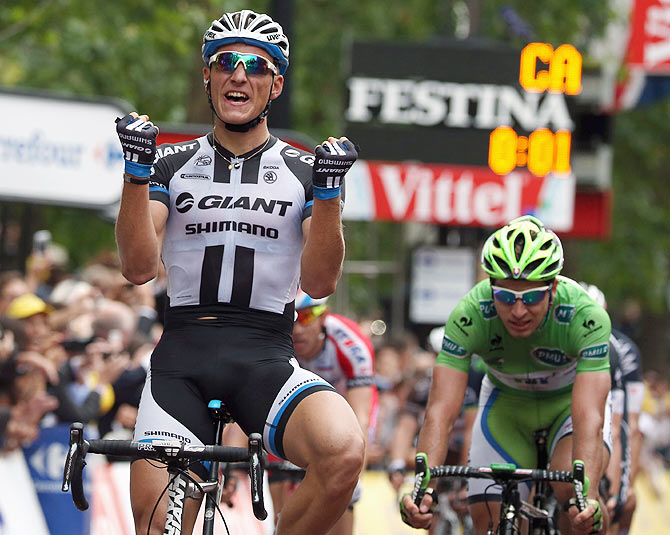 Marcel Kittel of Germany and Team Giant-Shimano celebrates as he wins stage three ahead of Peter Sagan (right) of Slovakia and Cannondale in second place in the 2014 Le Tour de France from Cambridge to London on Monday
