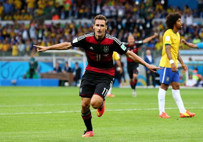 Miroslav Klose of Germany celebrates scoring his team's second goal on Tuesday