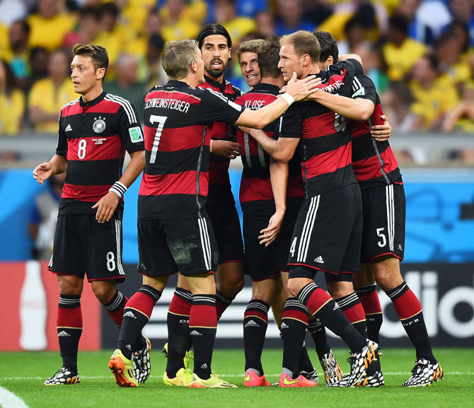 Thomas Mueller of Germany celebrates scoring his team's first goal with teammates