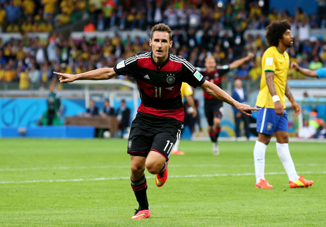 Miroslav Klose of Germany celebrates scoring his team's second goal