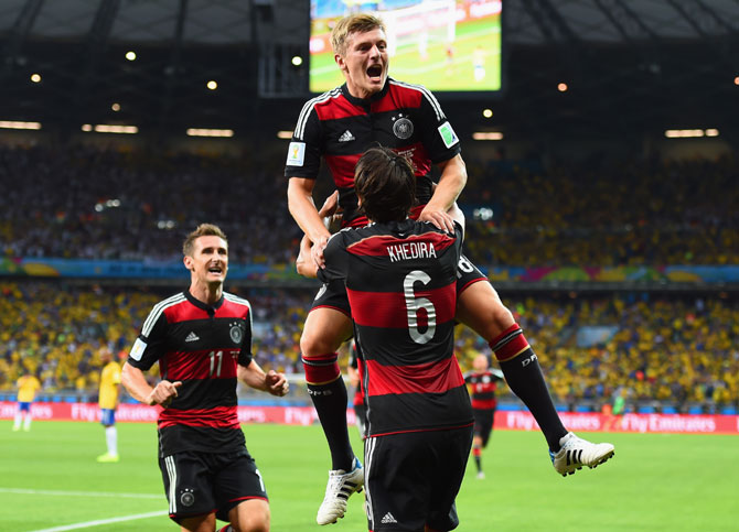 Toni Kroos of Germany celebrates scoring his team's third goal with teammates Miroslav Klose (left) and Sami Khedira