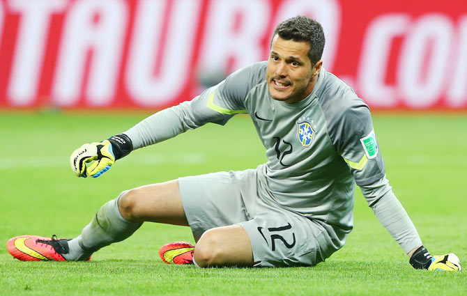 Goalkeeper Julio Cesar of Brazil reacts after letting in a goal against Germany on Tuesday