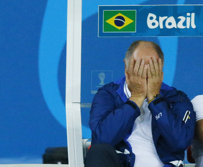 Brazil's coach Luiz Felipe Scolari reacts during his team's 2014 World Cup semi-finals against Germany at the Mineirao stadium in Belo Horizonte on Tuesday
