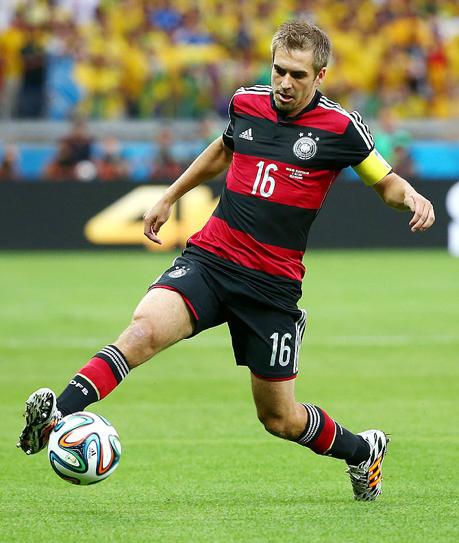 Philipp Lahm of Germany controls the ball during the 2014 FIFA World Cup semi-final against Brazil at Estadio Mineirao on Tuesday