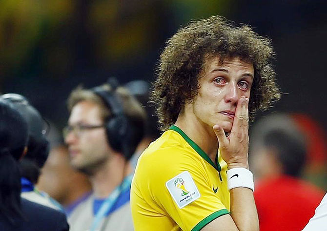Brazil's David Luiz cries after his team lost to Germany in their 2014 World Cup semi-finals at the Mineirao stadium in Belo Horizonte on Tuesday