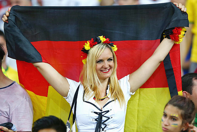 A Germany fan celebrates after their win over Brazil on Tuesday