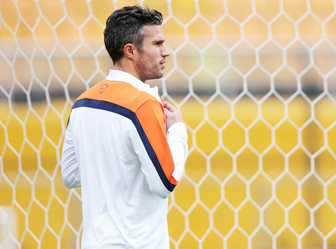 Robin van Persie looks on during the Netherlands training session at the 2014 FIFA World Cup Brazil held at the Estadio Paulo Machado de Carvalho Pacaembu in Sao Paulo on Tuesday